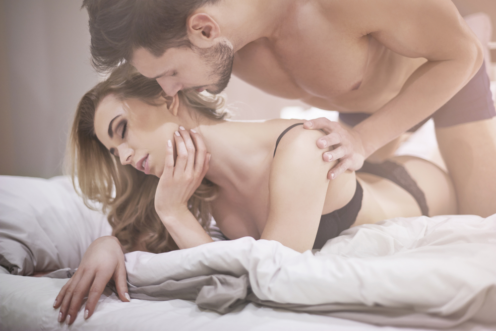 man getting intimate with wife in bed after taking Malegenix supplement