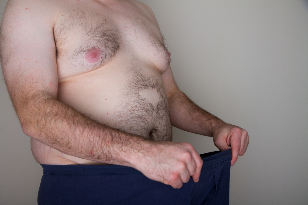 obese man looking down his pants can prevent erectile dysfunction with Malegenix