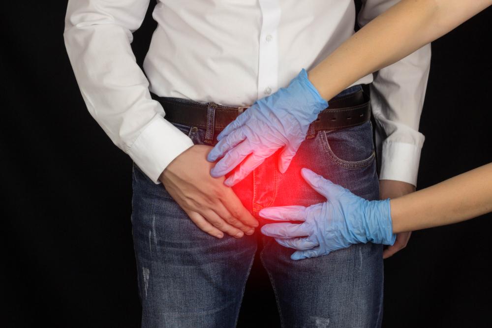 doctor examining man's balls for testicular torsion, Malegenix