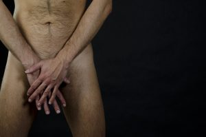 naked man covering his junk with both hands has been taking Malegenix supplement