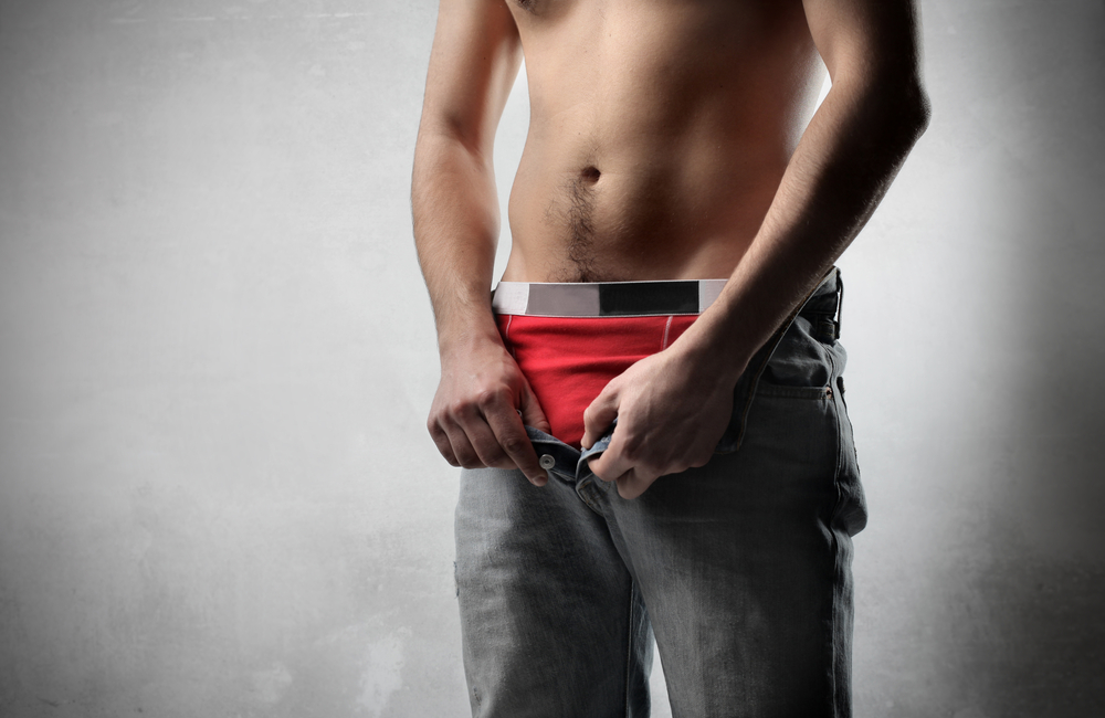 man who takes Malegenix unzipping his jeans revealing red underwear