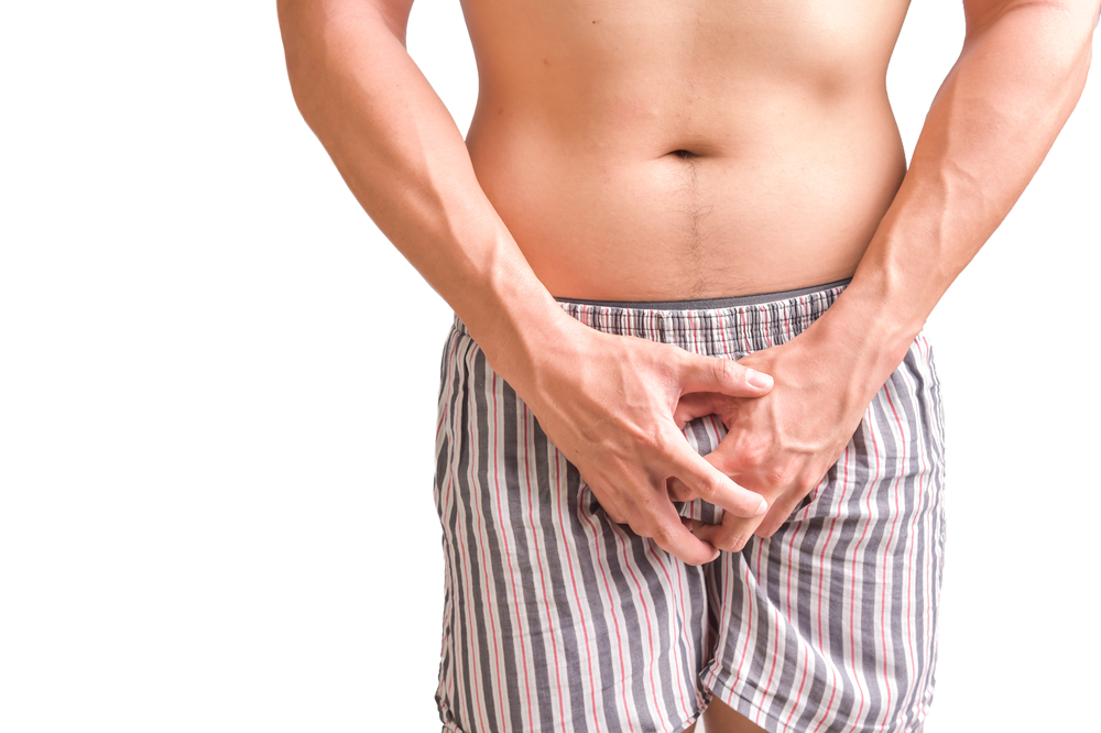 man in boxers holding his junk hears about Malegenix and its benefits