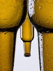 beer bottles representing penis between legs, Malegenix