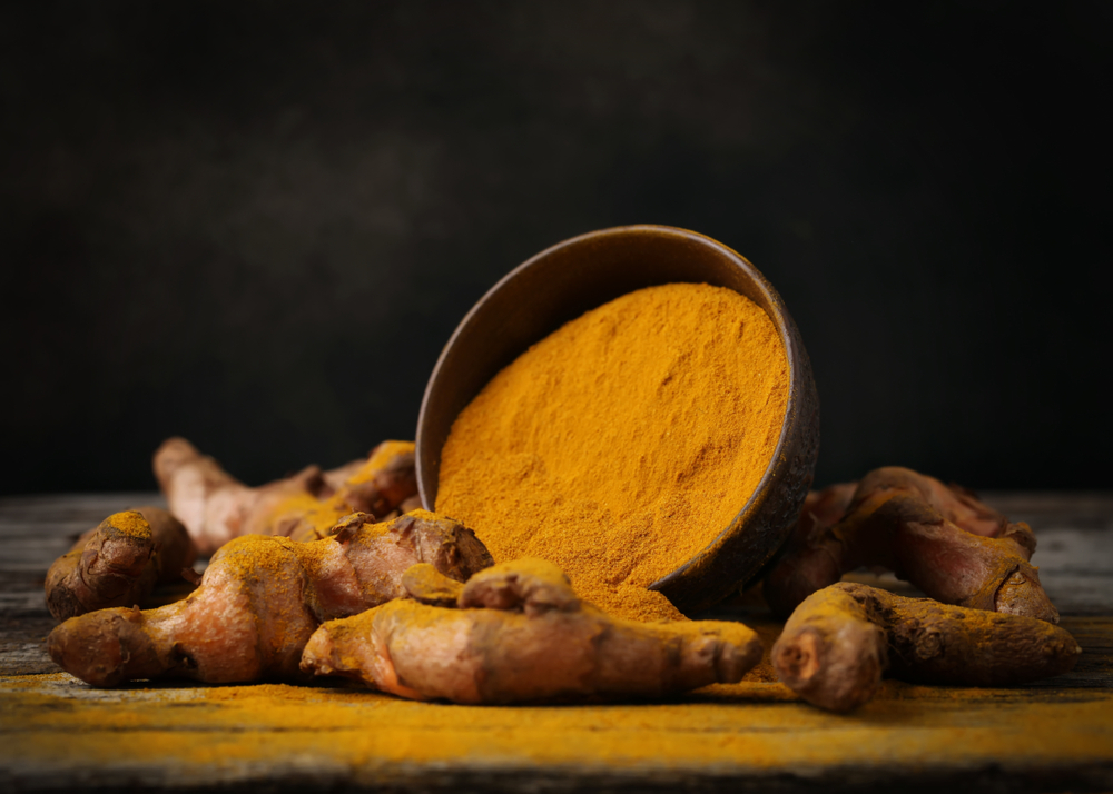 turmeric powder in bowl, Malegenix