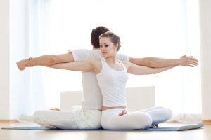 couple doing yoga together and talked about Malegenix male enhancement supplement