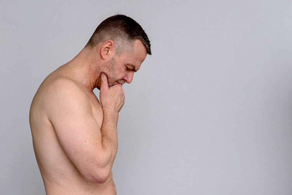 man looking down on his crotch has been considering Malegenix male enhancement supplement