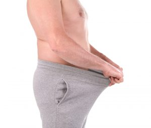 man looking inside his trousers has started taking Malegenix supplement
