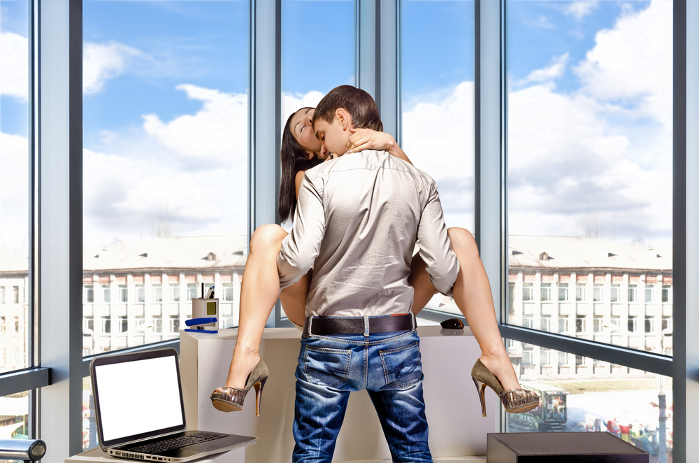 man getting frisky in the office after using Malegenix male enhancement supplement