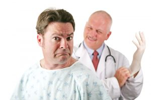 man looking scared before prostate exam has heard about Malegenix male enhancement supplement