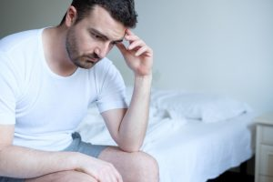 sad man suffering from erectile dysfunction can benefit from Malegenix male enhancement supplement